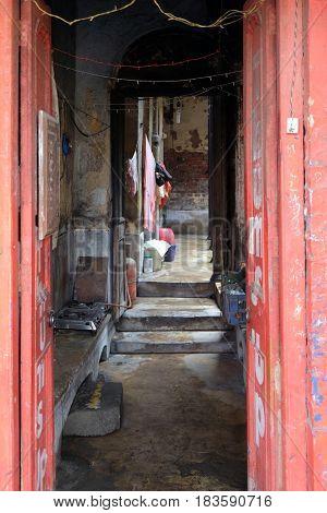 KOLKATA, INDIA - FEBRUARY 09: Entrance to the old Indian house through the open gate in Kolkata, India on February 09, 2016.