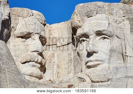 Close Up Picture Of Mount Rushmore National Memorial With Theodore Roosevelt And Abraham Lincoln.