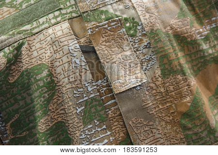 Camouflage uniform of an infantryman closeup. Backgrounds and textures