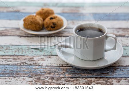 Coffee and pastries on turquoise vintage table