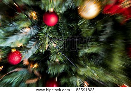 Zoom Blast (motion Blur) Shot Of Red And Gold Christmas Decorations And Fairy Lights On A Christmas