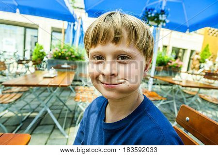 happy smiling child enjoys eating with full mouth