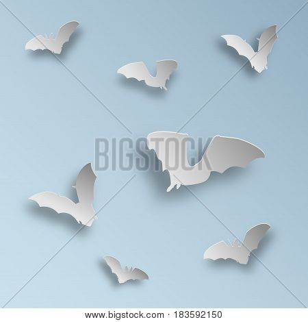 Flock of bats in paper art style on a light blue background. Flying bats silhouettes with shadows. Vector illustration.