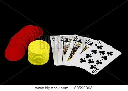 A winning poker hand with chips on black background