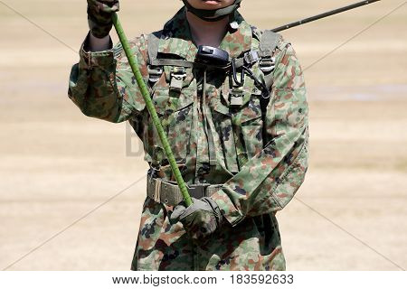 Japanese soldier with military camouflage uniform closeup