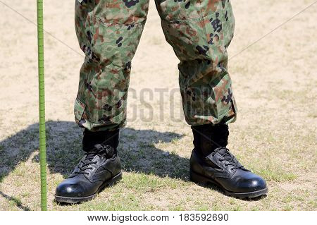 Soldier standing with lightweight military boots closeup