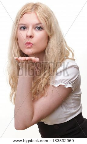 beautiful young blonde woman blowing a kiss
