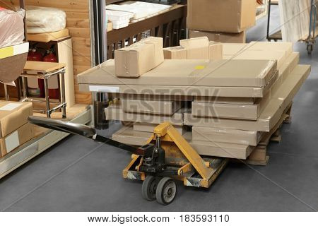 Packs with goods in wholesale warehouse