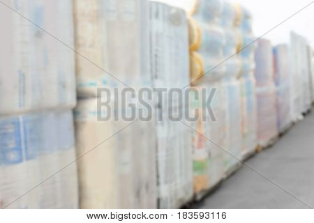 Packs with goods for wholesale distribution outdoors, blurred view
