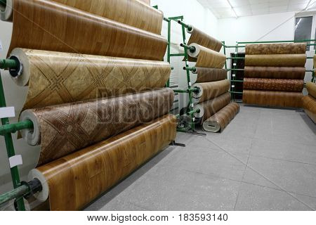 Racks with linoleum rolls in wholesale warehouse