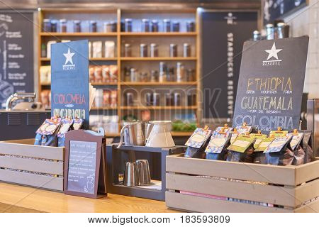 SAINT PETERSBURG, RUSSIA - CIRCA APRIL, 2017: goods on display in Starbucks coffee shop. Starbucks Corporation is an American coffee company and coffeehouse chain.