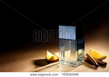 Composition with modern male perfume on color background