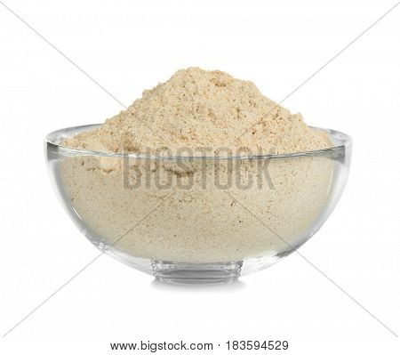 Glass bowl with flour on white background