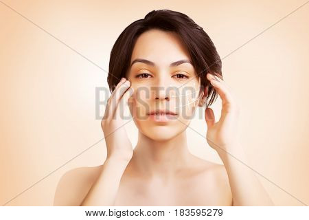 gorgeous japanese dark haired model portrait with skin surgery mark isolated on white background