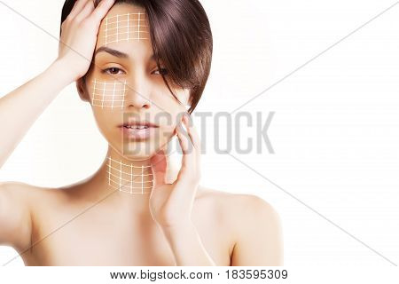 young asian anime looking model holds hands for product marks on face