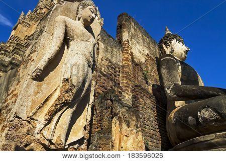 Sculpture buddha beauty with clear sky at Wat Phra Si Ratanamahathat in Sisatchanalai Historical Park Sukhothai province Thailand