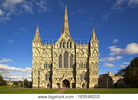 Salisbury Cathedral which has the tallest church spire in the UK photographed on a sunny day.