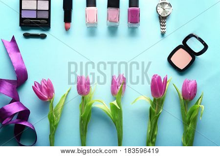 Beautiful composition of cosmetics with tulips on table