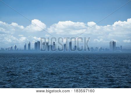 great amazing view of Toronto city background standing in dark blue lake Ontario with hazy smoky  horizon line on moody sky background