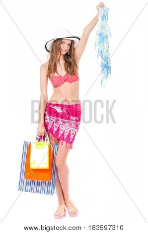 Pretty girl posing in bikini with shopping bags, isolated on white background