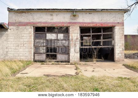 Haunting image of an abandoned forgotten service garage taken in an economically depressed community on the rural Kansas Plains