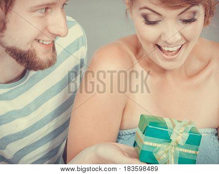 Young Man Giving Woman Gift Box