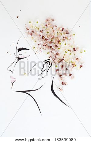 Hand drawn female profile with natural blossom flowers hairstyle isolated over white. Fashion illustration