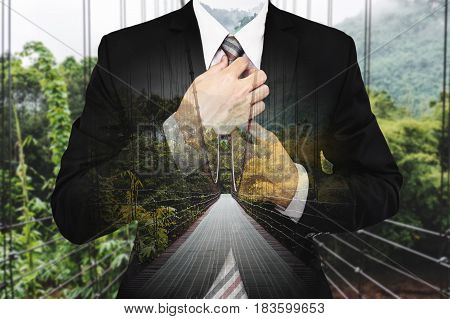 Double Exposure Businessman with bridge way and green forest