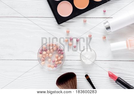 cosmetics composition with palette and lavender flowers on white woman desk background top view