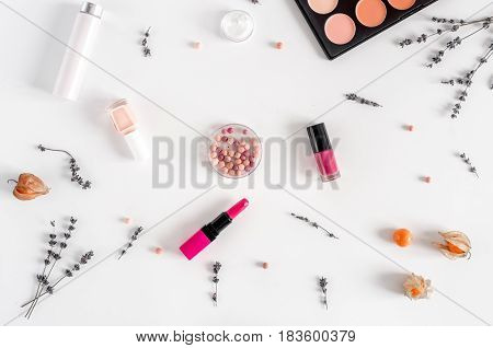 trendy woman desk with decorative cosmetic and lavender flowers on white background top view