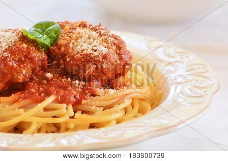 Rich and hearty spaghetti and meatballs in marinara sauce. Closeup with room for text.