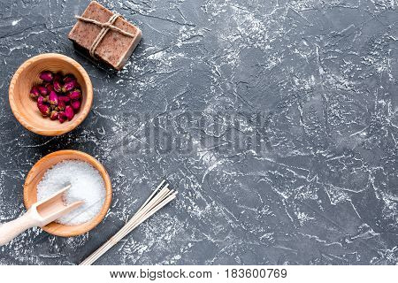 spa set with salt and organic soap on dark table background top view mock up