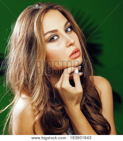 young cute blonde woman on green palm background smiling happy, lifestyle peole concept close up