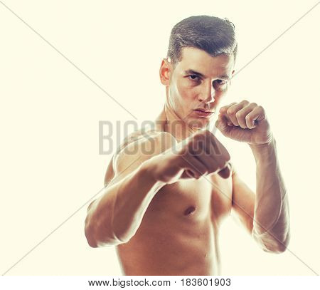 young handsome naked torso man boxing on white background isolated, lifestyle sport agressive people concept close up