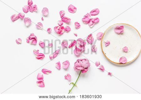 flat lay with rosemary and rose petals and plate on white woman desk background top view mockup