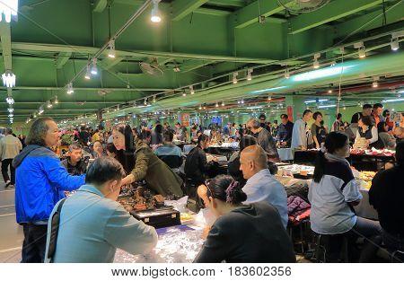 TAIPEI TAIWAN - DECEMBER 3, 2016: Unidentified people visit Jianguo weekend Jade Market. Jianguo Jade Market is a major Jade market in Taipei.