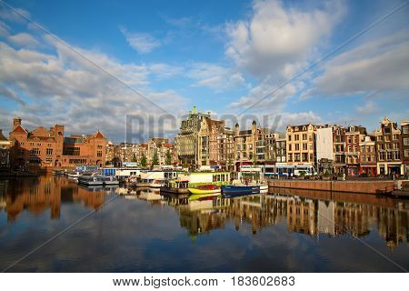AMSTERDAM - JULY 10: Early morning in the Amsterdam city on July 10, 2016 in Amsterdam, Netherlands. The historical canals of the city is one of the main attractions of Amsterdam.