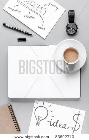 business plan with copybook and hand-drawn chart in management set on gray office table background top view mockup