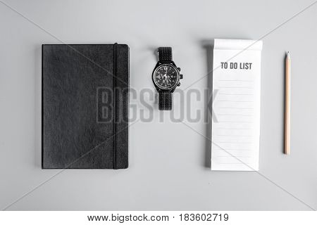 set for business strategy with to do list and notebook on gray office table background top view mock up