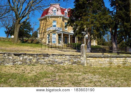 Historic stone mansion built in the 1880s taken at Spring Hill Ranch on the Kansas Prairie