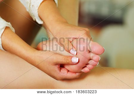 Pain in the foot. Massage of female feet. Pedicure