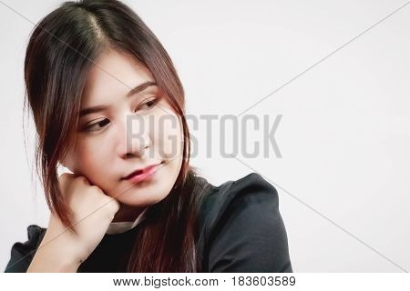 Attractive Asian woman thinking pondering isolated on white background.