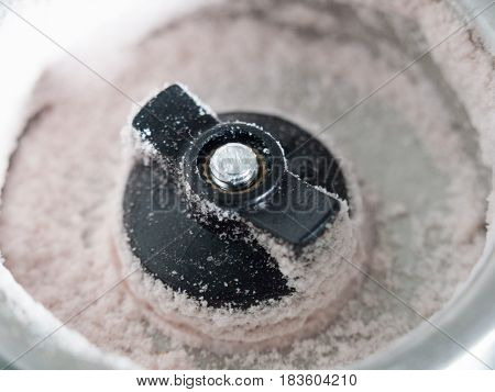 Close Up Macro Of The Bottom Of A Salt Shaker Dispenser With Grains Of Salt