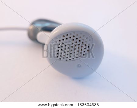 Close Up Of A Single Headphone, Gummy Headphone On White Background