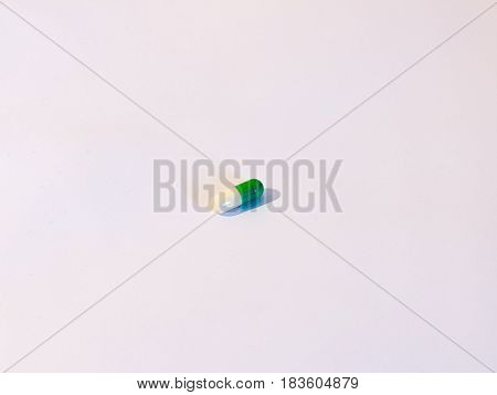 One Pill On A Background Of White, A White And Green Tablet Antidepressant Drug Generic