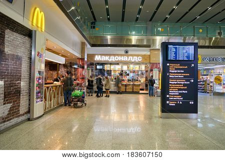 SAINT PETERSBURG, RUSSIA - CIRCA APRIL, 2017: McDonald's restaurant at Pulkovo airport. McDonald's is an American hamburger and fast food restaurant chain.