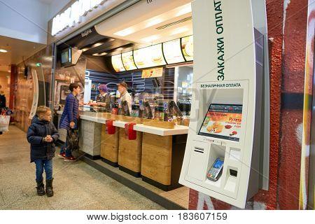 SAINT PETERSBURG, RUSSIA - CIRCA APRIL, 2017: McDonald's restaurant at Pulkovo airport. McDonald's is an American hamburger and fast food restaurant chain.