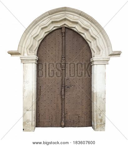 Old wooden front door with stone portal isolated on whitewith clipping path