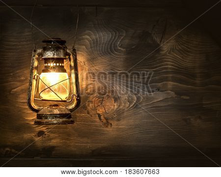 The old kerosene lantern hanging on the wooden wall