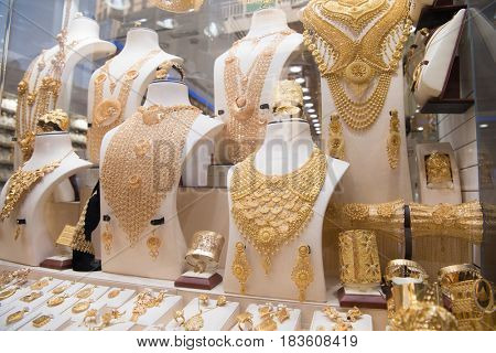 Fashion jewelry from yellow and white gold, on a window shop